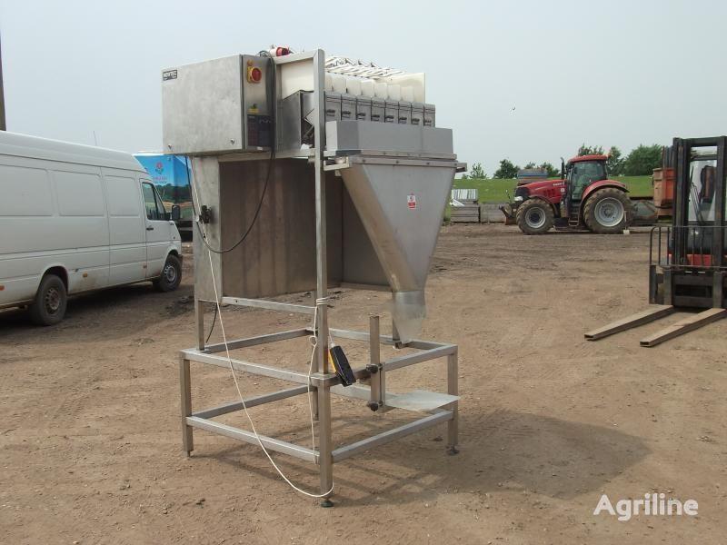 NEWTEC (vesovaya stanciya - 8-mi chashechnaya) packing machine