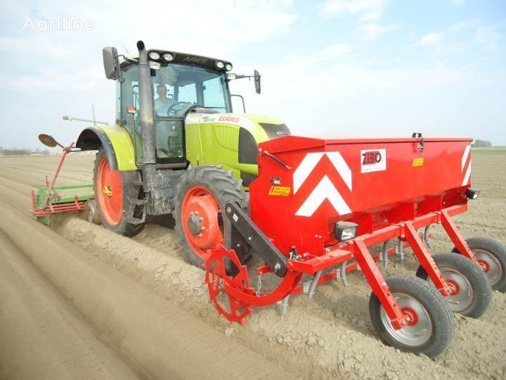 new Ustroystvo dlya vneseniya udobreniy neposredstvenno v greben potato planter
