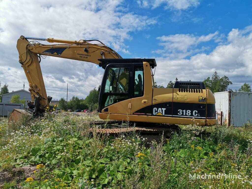 CATERPILLAR 318 CL + Excadrill 22A tracked excavator