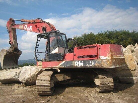 damaged O&K RH12 tracked excavator