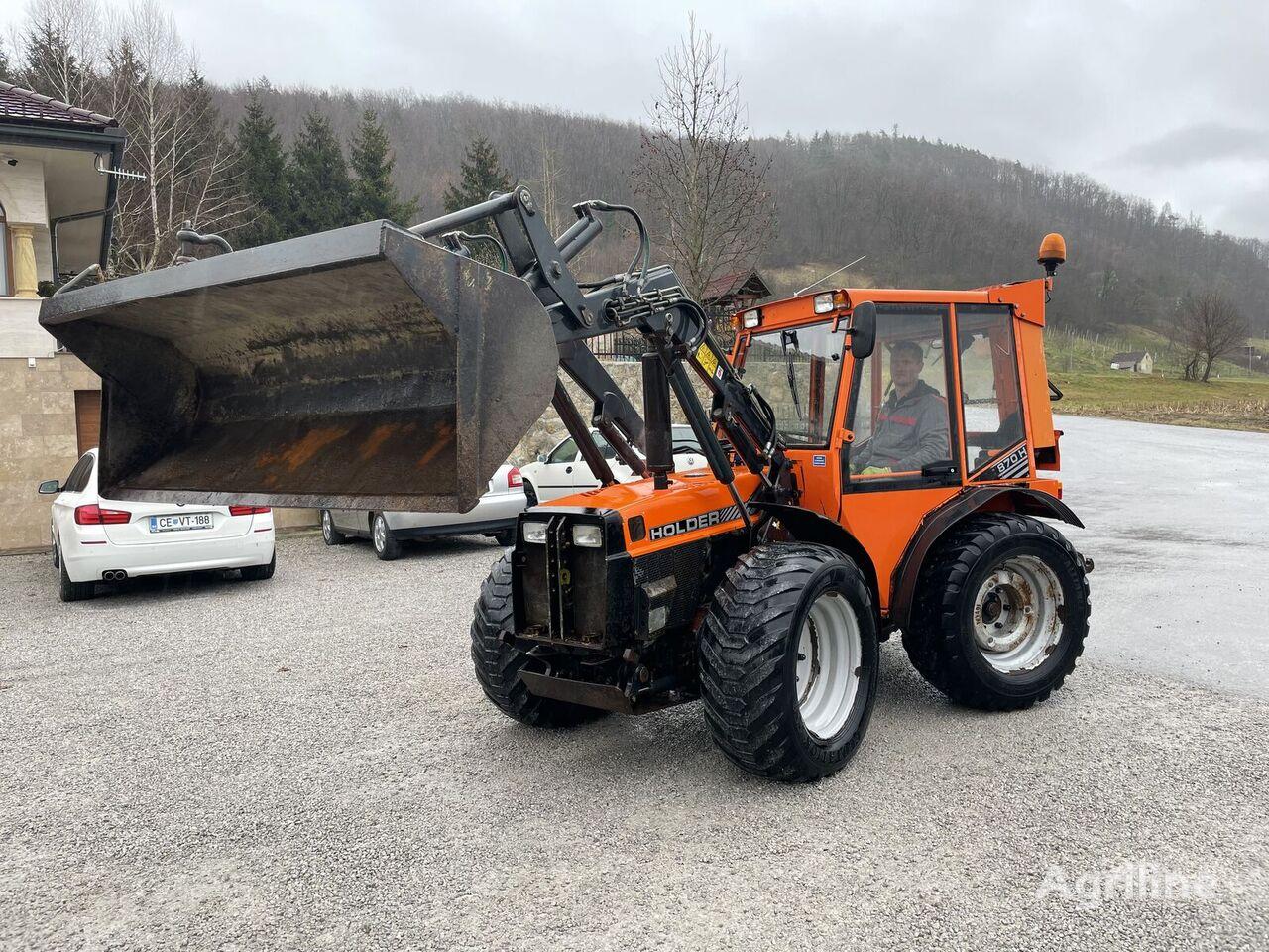 HOLDER C870 H  wheel tractor