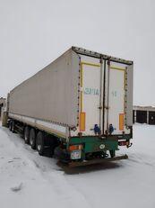 MAZ 975800 tilt semi-trailer