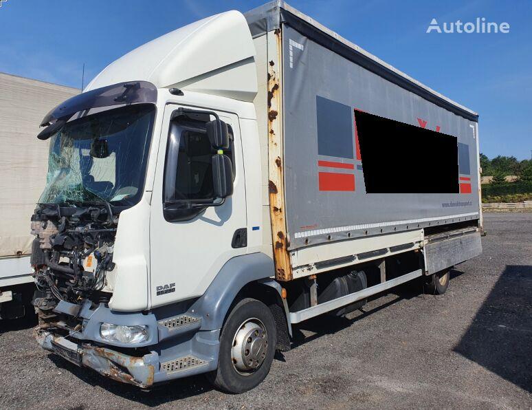 damaged DAF LF 55 250 EEV curtainsider truck
