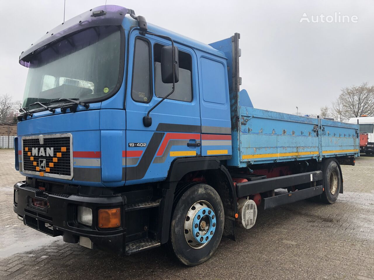 MAN 19.402 flatbed truck