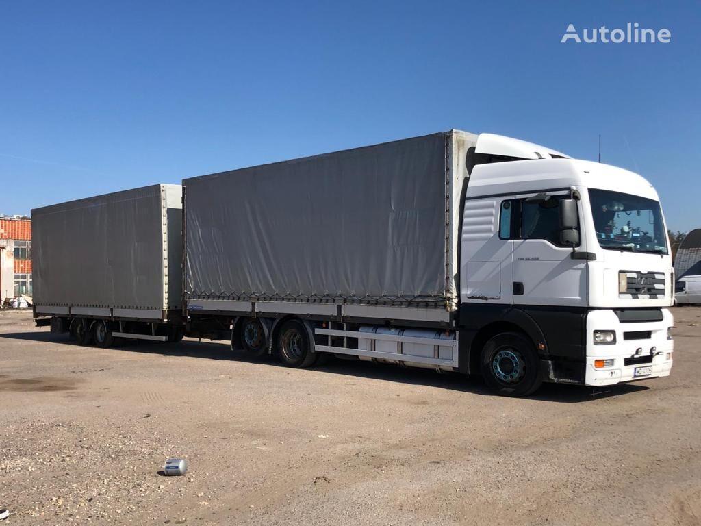 MAN TGA 26.400 tilt truck + tilt trailer
