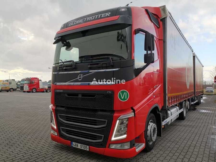 VOLVO FH tilt truck + curtain side trailer